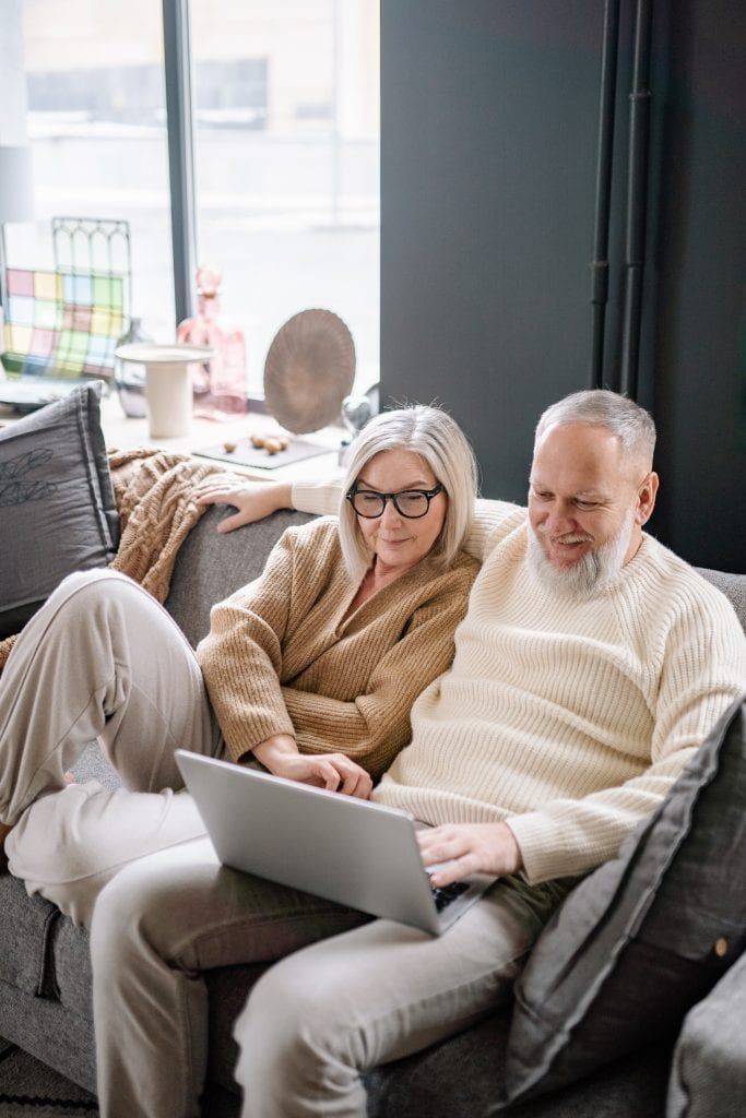 A couple watching videos for tips on staying up to date with advancing technology trends.